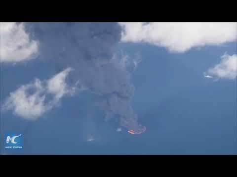 Burning oil tanker sinks in East China Sea