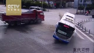 Bus loses control, rolls over after truck collision
