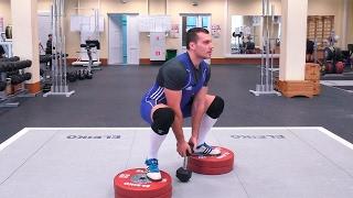 Приседания с весом между ног: техника и нюансы