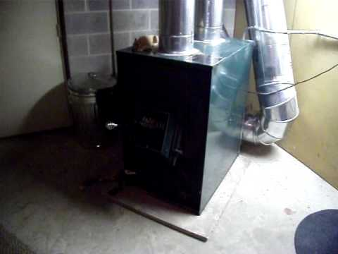 Hot Blast Wood Furnace Tied Into Return Using Oil Heat As