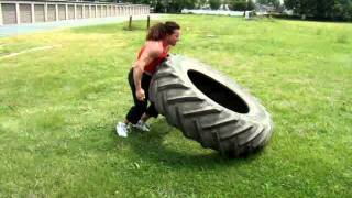 justine dohring female bodybuilder personal trainer tire flip