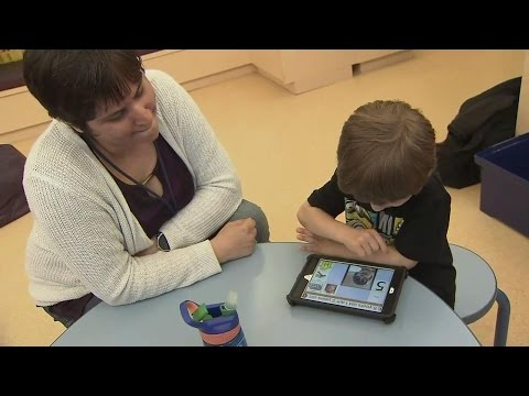 Non-verbal children living with autism learning to communicate via electronic devices
