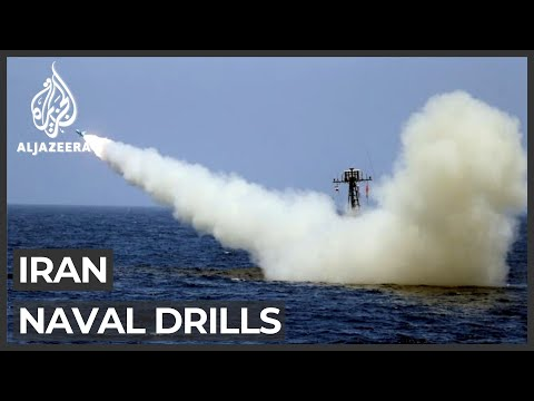 Iran fires missile at mock US aircraft carrier during exercise
