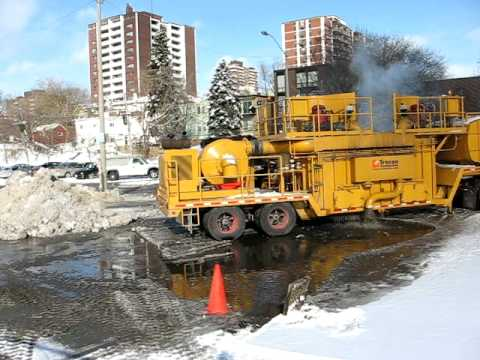 Snow Melter Clears Mountain Of Snow