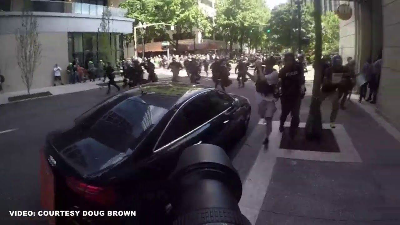 Video shows officers rushing, shoving counter-protesters at Portland rally