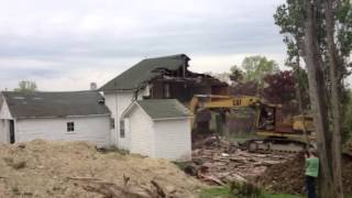 Excavator Rampage on House