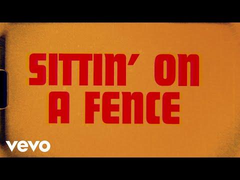 Sittin' On A Fence (Lyric Video)