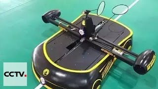 China robot challenges human players in badminton