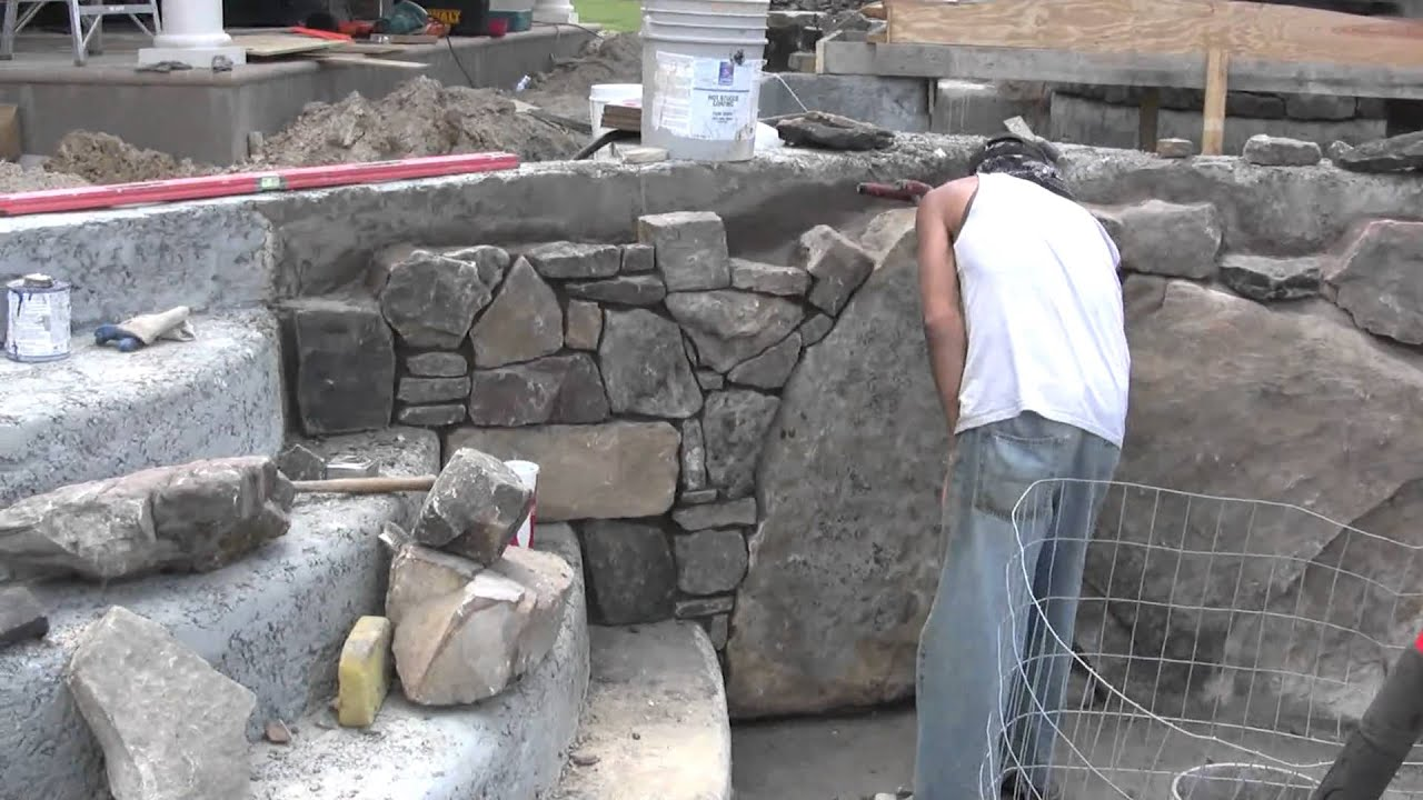 Pool design progress of new pool construction for natural stone swimming pool and spa youtube Natural swimming pool builders