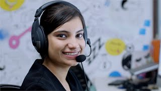 Young Indian customer service / call center representative smiles at the camera