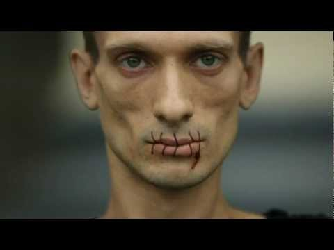 Pussy Riot protest: Russian artist sews his mouth together in support