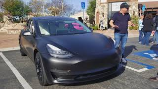 Tesla Model 3 wrapped in matte black and white seats