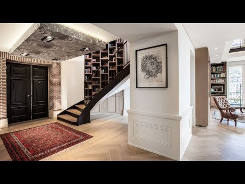 A spacious double story Cape Town apartment surprises with an extraordinary library | Top Billing