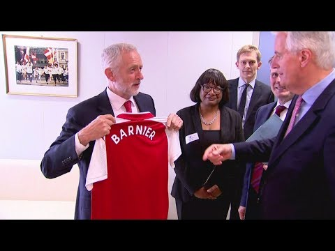 Jeremy Corbyn gives EU's chief negotiator an Arsenal shirt
