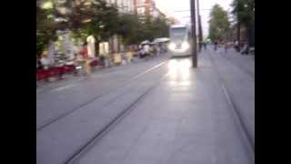 Pedestrians, tramways and bikes sharing space in Seville