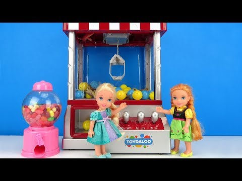 Claw Machine ! Elsa and Anna toddlers win prizes  Arcade game room