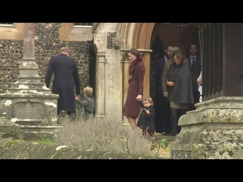 Prince George and Princess Charlotte hold candy canes