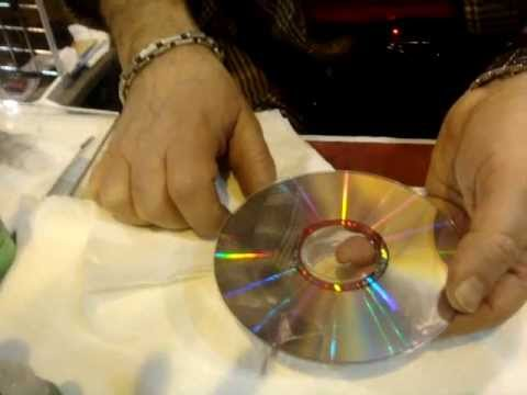 How to Clean  and protect CD with professional Glass Cleaner.