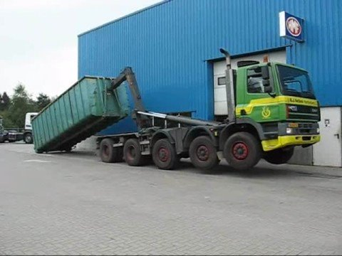 Hyvalift 40 Tons Hookloader on GINAF 10x4 lifting a heavy container