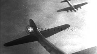 A burning American B-17 aircraft falls through clouds in Germany. HD Stock Footage