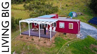 Off-the-grid 40ft Shipping Container Home Even Charges Electric Car