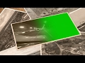 old pictures on a table video background with green screen placeholder - 3