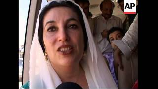 WRAP Bhutto arrives  back after eight years