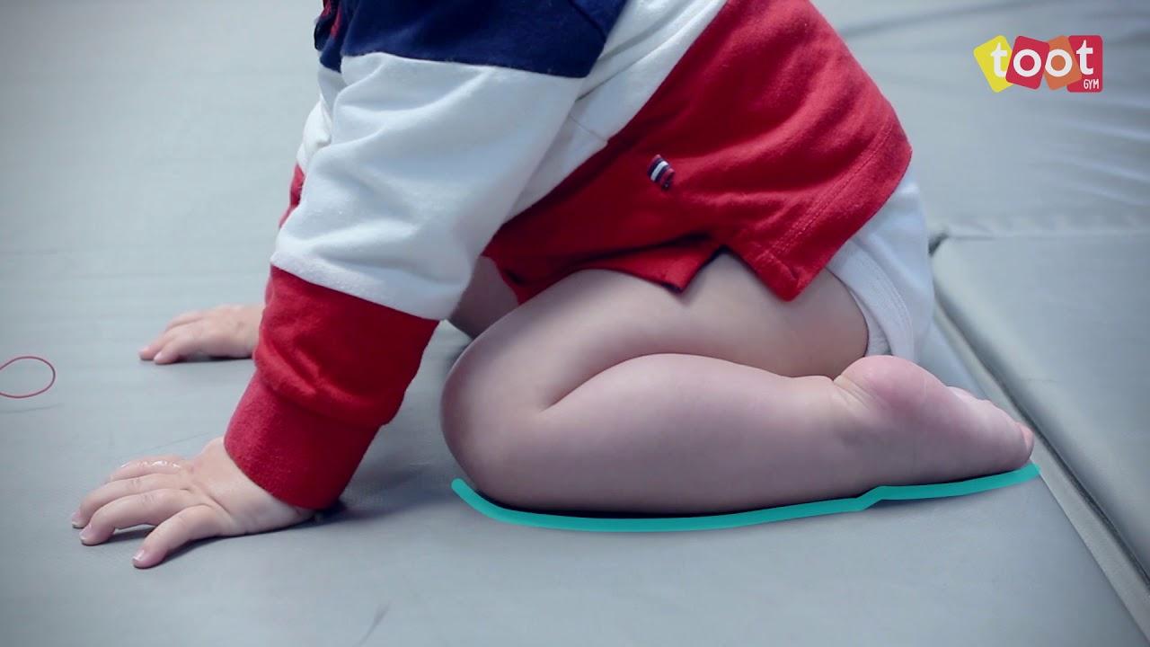 como enseñarle a gatear a tu bebe