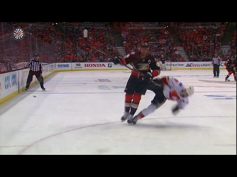 Getzlaf catches Giordano with his head down, Flames get penalty