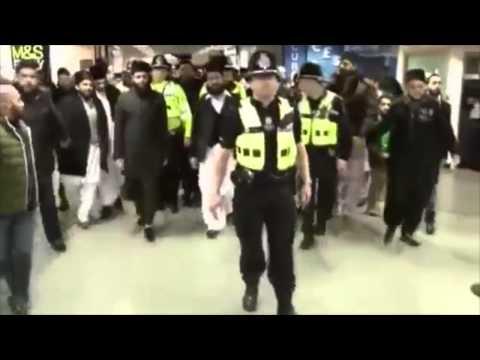 islamic preacher chanted as police escort him through Birmingham airport. 14 feb 2015