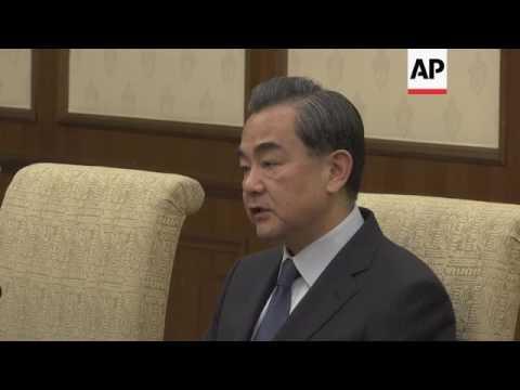 Japan FM Kishida meets counterpart Wang in China