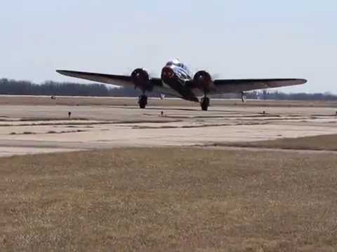 Lockheed Electra taxiing back to hangar after a perfect flight.