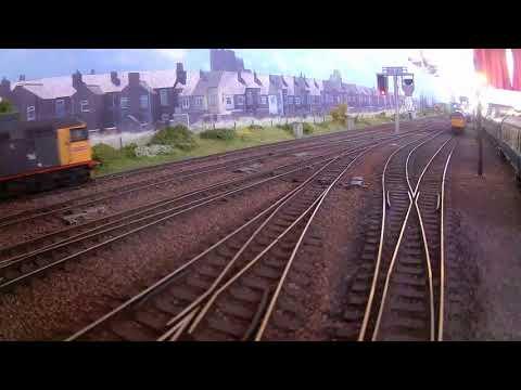 D200 passes Haymarket MPD, followed by Railfreight 26025