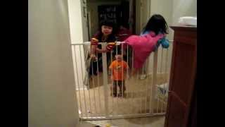 My Twin Girls, At 26 Months, Climbing Over Kidco Extra Tall Baby Gate.  42 Inches Tall!