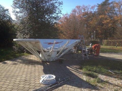 Skybrokers de-installing an Andrew 4.6m Antenna in Geneva, Switzerland