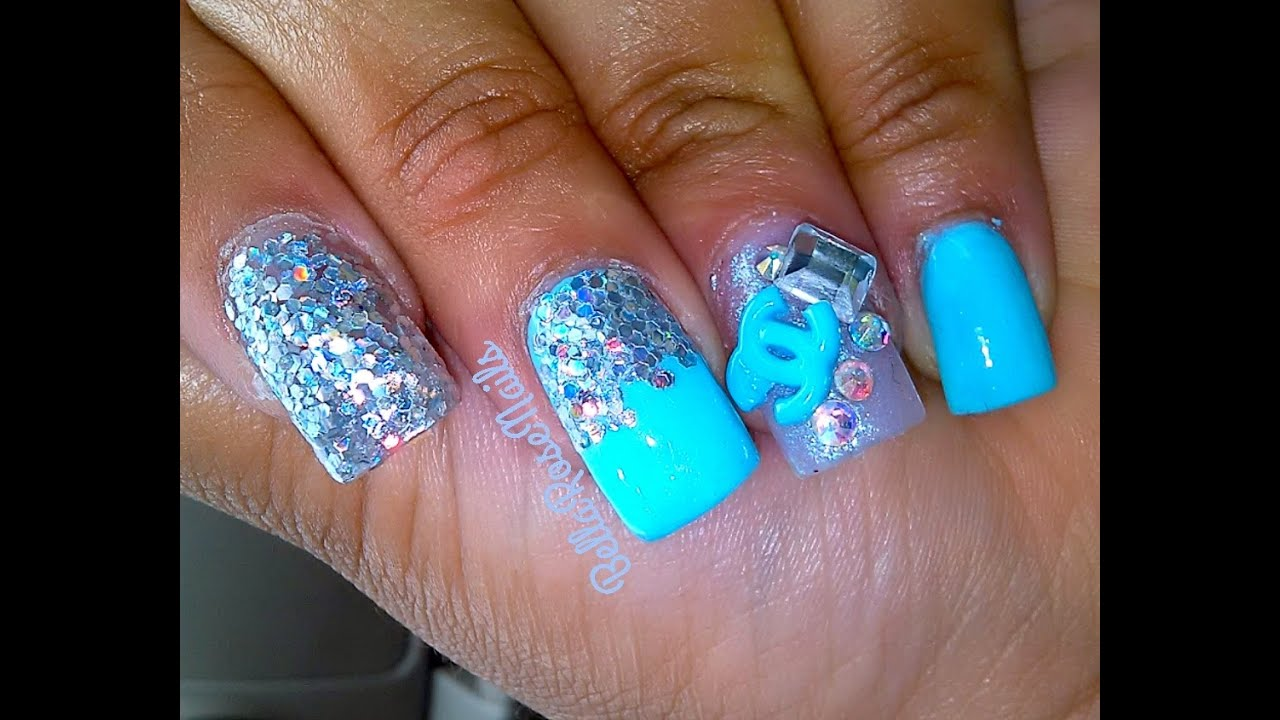 teal chanel acrylic nails