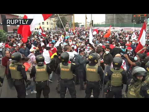 Peruvian presidential candidates' supporters fight as they a
