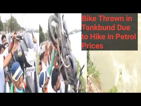 Telangana Youth Cong throws bike into Hussain Sagar protesting against fuel price hike