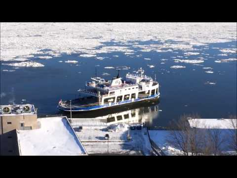 Ferry crossing across the frozen St-Lawrence River in Quebec