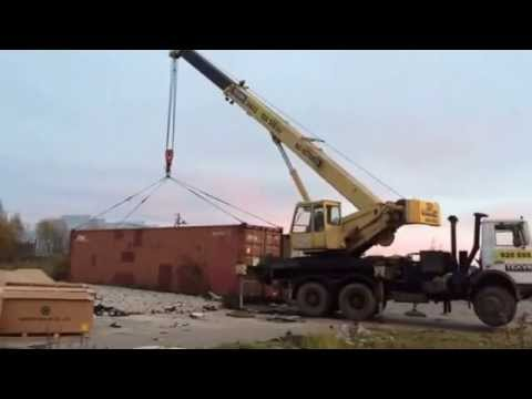 Кран 32 тонны поднимает загруженный контейнер 23 тонны