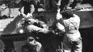 French tank crew removing body of dead soldier from tank and laying him on blanke...HD Stock Footage