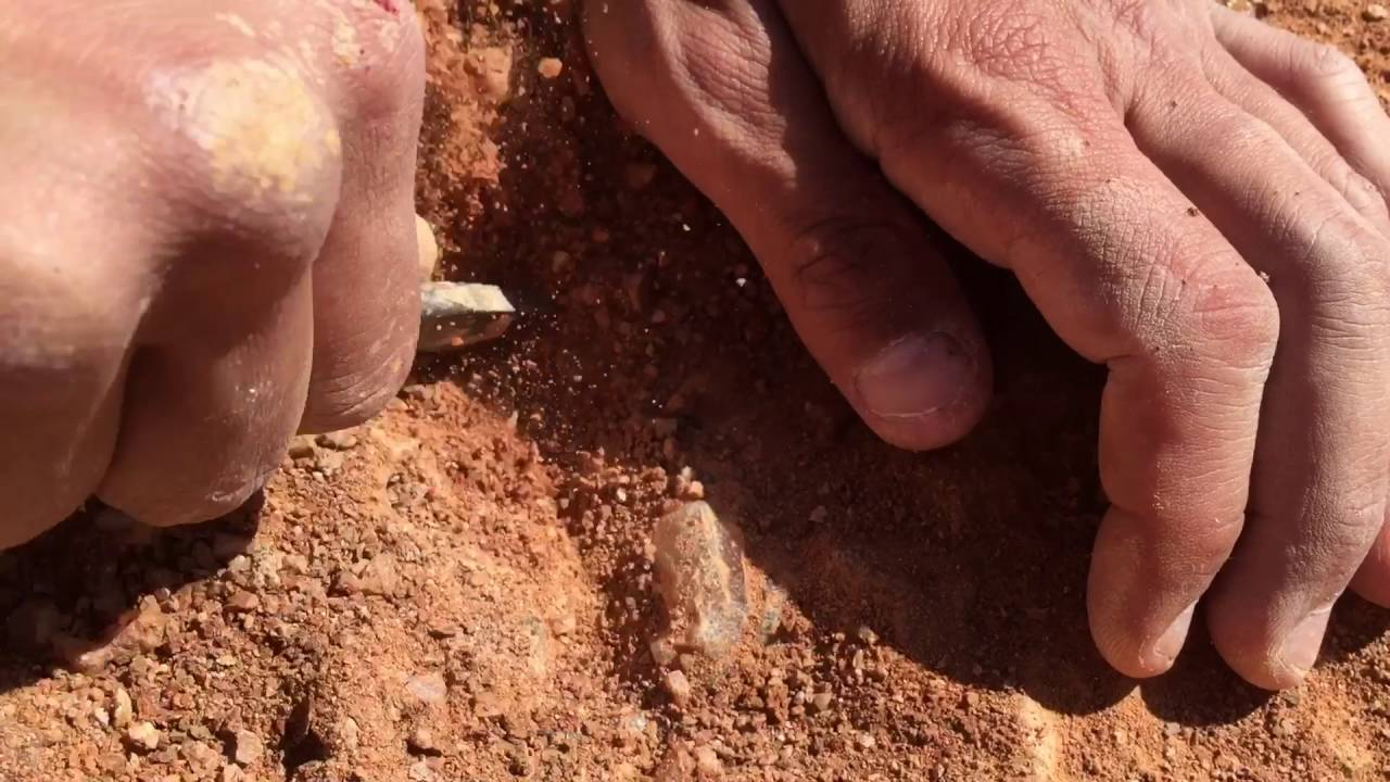 Digging a Quartz Crystal out of the ground