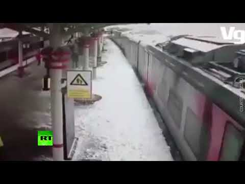 Snow 'avalanche' hits train arriving at station in Moscow