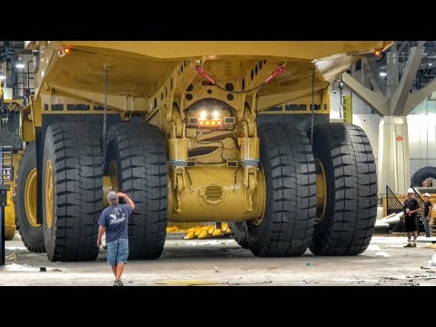 Moving a massive Caterpillar 794AC dump truck