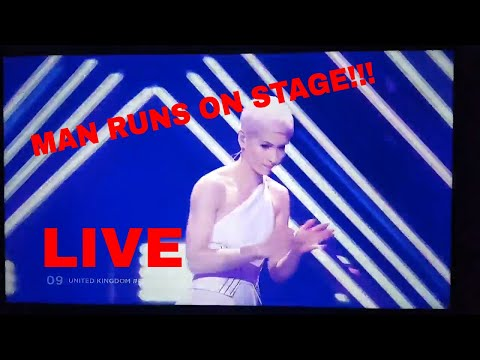 Man grabs microphone during live Great Britain Eurovision performance and gets tackled!!! (LIVE)