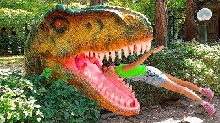 Alena with mom play in the dinosaur park