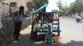 Manual man powered Sugar Cane Juice vendor at Lunciqui in Navsari, Gujarat, India; 15h May 2012