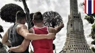 American tourists arrested Thailand: Couple busted for cheeky Buddhist temple snap - TomoNews