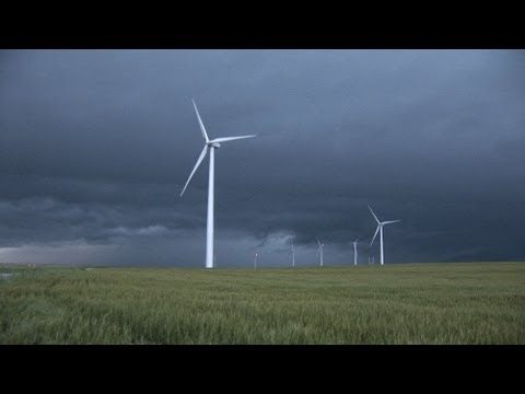 (HD) Storm causes wind turbines to change direction after wind shift
