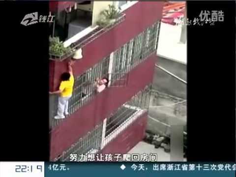 Boy Hangs Off 4th-story Balcony In Guangdong, China